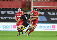 Scarlets' Lewis Rawlins evades the tackle of Ospreys' Scott Otten<br /> <br /> Photographer Ashley Crowden/CameraSport<br /> <br /> Guinness Pro14 Round 6 - Ospreys v Scarlets - Saturday 7th October 2017 - Liberty Stadium - Swansea<br /> <br /> World Copyright &copy; 2017 CameraSport. All rights reserved. 43 Linden Ave. Countesthorpe. Leicester. England. LE8 5PG - Tel: +44 (0) 116 277 4147 - admin@camerasport.com - www.camerasport.com
