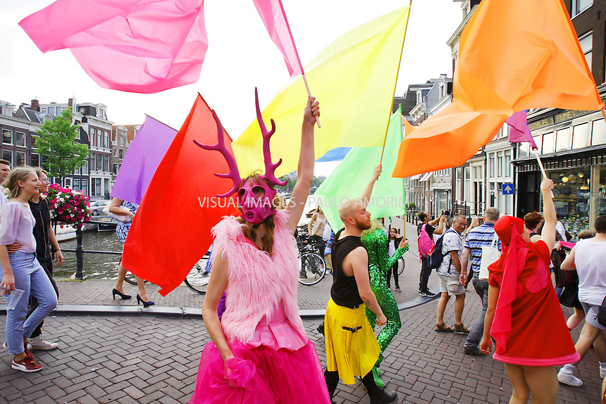 Participants walk through the streets of Amsterdam, Netherlands on July 23, 2016 during the Pride Walk starting  the Europride 2016 parade of lesbian, gay, bisexual and transgender (LGBT). Some ten thousand  gay rights supporters and activists marched as a sign against homophobia and fight for tolerance and respect. EuroPride, first held in 1991, takes place in a different European city every year and is being hosted by the Dutch capital in 2016 to mark 20 years of the Amsterdam Gay Pride organisation. This year the event has the motto ''join our freedom'. Imago/Paulo Amorim