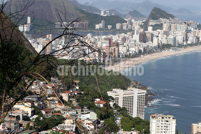 From the top of the Vidigal slum  in Rio de Janeiro it can seen Leblon beach and and impress view of this city of Brazil