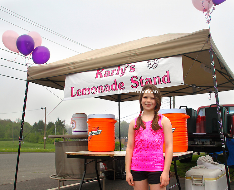 PROSPECT, CT 21 MAY, 2011-052111JW01- Karly Laliberte age 9 poses for a photo at her lemonade stand Saturday morning at the Prospect Town Hall. Laliberte is using the stand to raise money for a donation in honor of her grandmother Nancy Mulcahey who died of cancer in 2004 to the American Cancer Society's Relay for Life happening June 4th 2011 at Crosby High School.<br /> Jonathan Wilcox Republican-American
