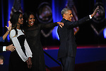 President Barack Obama's daughter Malia, First Lady Michelle Obama and President Obama after he gave his farewell address to a crowd of thousands and the nation during his farewell address at McCormick Place in Chicago, Illinois on January 10, 2017.