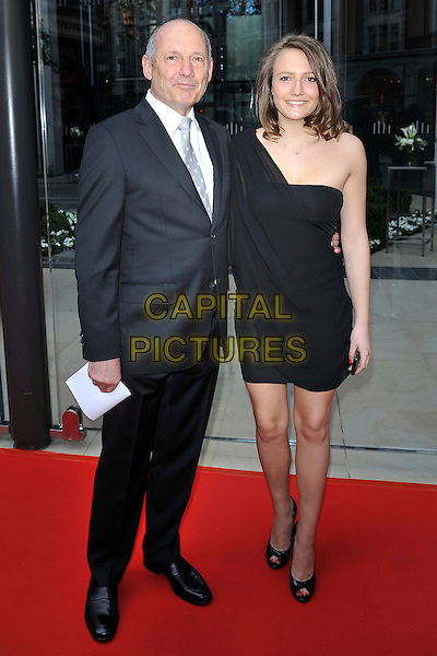 Ron Dennis & daughter .attending the McLaren Car Showroom Launch at One Hyde Park, Knightsbridge, London, England, UK, June 21st 2011..full length suit tie black one shoulder dress family tie grey gray family dad father .CAP/MAR.© Martin Harris/Capital Pictures.