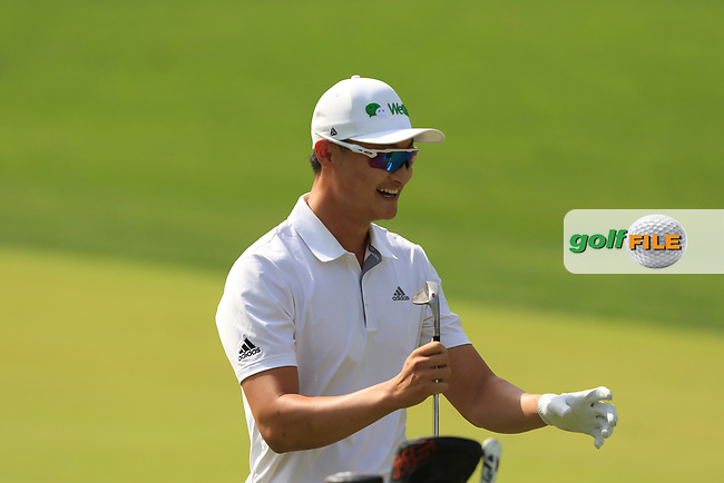Haotong Li (CHN) on the 1st fairway during Round 4 of the Omega Dubai Desert Classic, Emirates Golf Club, Dubai,  United Arab Emirates. 27/01/2019<br /> Picture: Golffile | Thos Caffrey<br /> <br /> <br /> All photo usage must carry mandatory copyright credit (© Golffile | Thos Caffrey)