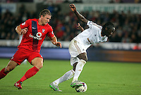Pictured: Eder of Swansea (R) gets past Dave Winfield of York City (L) Tuesday 25 August 2015<br /> Re: Capital One Cup, Round Two, Swansea City v York City at the Liberty Stadium, Swansea, UK.
