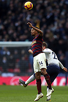Isaac Hayden of Newcastle United and Christian Eriksen of Tottenham Hotspur during Tottenham Hotspur vs Newcastle United, Premier League Football at Wembley Stadium on 2nd February 2019