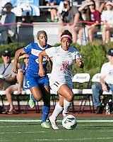 In a National Women's Soccer League Elite (NWSL) match, the Boston Breakers defeated the FC Kansas City, 1-0, at Dilboy Stadium on August 10, 2013.  FC Kansas City midfielder Desiree Scott (11) moves the ball towards center field with Boston Breakers defender Jazmyne Avant (5) in pursuit.