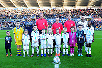 Alex Mowatt of Barnsley and Matt Grimes of Swansea City with mascots during the Sky Bet Championship match between Swansea City and Barnsley at the Liberty Stadium in Swansea, Wales, UK. Sunday 29 December 2019