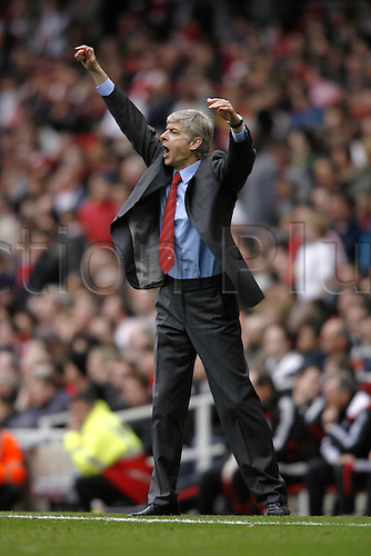 5 April 2008: Arsenal manager Arsene Wenger issues instructions from the touchline during the Premier League game between Arsenal and Liverpool played at The Emirates Stadium. The game finished 1-1 Photo: Actionplus....080405 coach coaches.