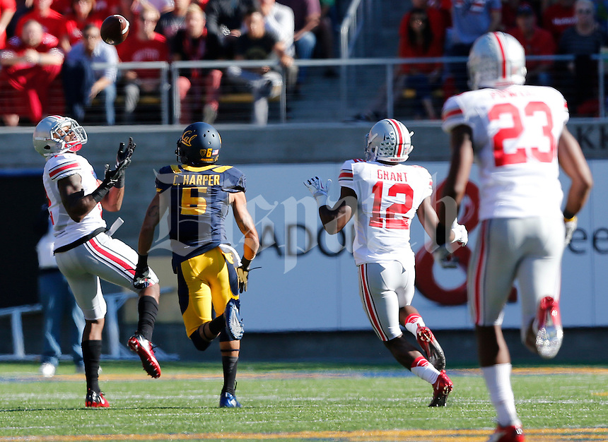 Ohio State Buckeyes safety Christian Bryant (2) catches an interception in the second quarter of the NCAA football game at Memorial Stadium in Berkeley, California,  Saturday afternoon, September 14, 2013. The Ohio State Buckeyes defeated the California Golden Bears 52 - 34. (The Columbus Dispatch / Eamon Queeney)