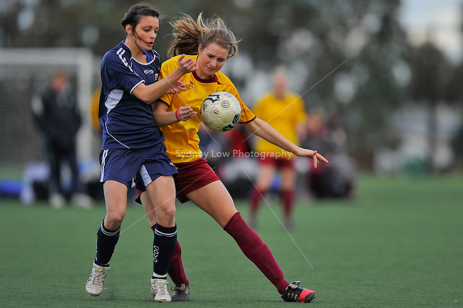 MELBOURNE, AUSTRALIA - 26 June: Ellvana Curo of Altona City wins the ball againt Brittany Patafio of VCL Country in the round 12 Women's Premier League match between VCL Country and Altona City at Darebin International Sports Centre on 26 June 2011 in Melbourne, Australia. (Photo Sydney Low / AsteriskImages.com)