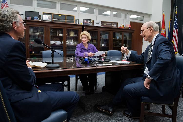 UNITED STATES - JULY 12: Senate Agriculture Committee Chairman Pat Roberts, R-Kan., right, and ranking member Sen. Debbie Stabenow, D-Mich., prepare for a podcast with CQ editor Shawn Zeller in Hart Building on July 12, 2018. (Photo By Tom Williams/CQ Roll Call)