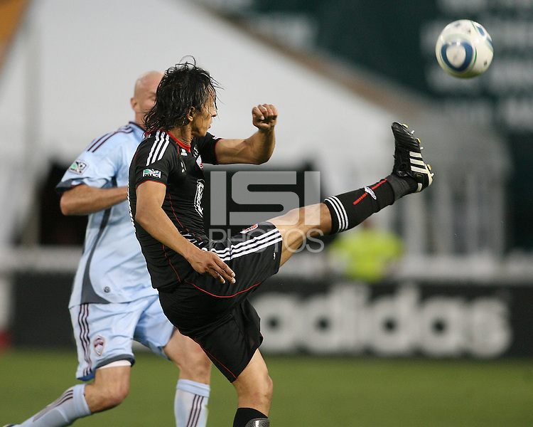 Juan Manuel Pena #3 of D.C. United boots the ball away from Conor Casey #9 of the Colorado Rapids during an MLS match on May 15 2010, at RFK Stadium in Washington D.C. Colorado won 1-0.