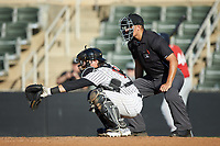 Kannapolis Intimidators catcher Michael Hickman (18) sets a target as home plate umpire Justin Whiddon looks on during the game against the Lakewood BlueClaws at Kannapolis Intimidators Stadium on July 8, 2018 in Kannapolis, North Carolina.  The BlueClaws defeated the Intimidators 4-3.  (Brian Westerholt/Four Seam Images)