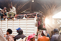 A truck full of onions arrives at  the main produce market in Nairobi, Kenya.