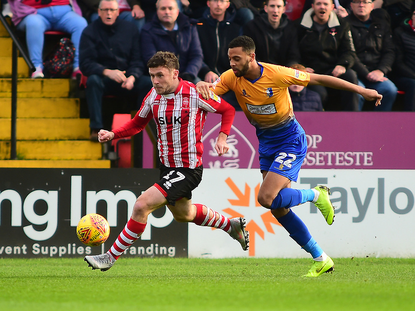 Lincoln City's Shay McCartan gets away from Mansfield Town's CJ Hamilton<br /> <br /> Photographer Andrew Vaughan/CameraSport<br /> <br /> The EFL Sky Bet League Two - Lincoln City v Mansfield Town - Saturday 24th November 2018 - Sincil Bank - Lincoln<br /> <br /> World Copyright © 2018 CameraSport. All rights reserved. 43 Linden Ave. Countesthorpe. Leicester. England. LE8 5PG - Tel: +44 (0) 116 277 4147 - admin@camerasport.com - www.camerasport.com