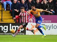 Lincoln City's Shay McCartan gets away from Mansfield Town's CJ Hamilton<br /> <br /> Photographer Andrew Vaughan/CameraSport<br /> <br /> The EFL Sky Bet League Two - Lincoln City v Mansfield Town - Saturday 24th November 2018 - Sincil Bank - Lincoln<br /> <br /> World Copyright &copy; 2018 CameraSport. All rights reserved. 43 Linden Ave. Countesthorpe. Leicester. England. LE8 5PG - Tel: +44 (0) 116 277 4147 - admin@camerasport.com - www.camerasport.com