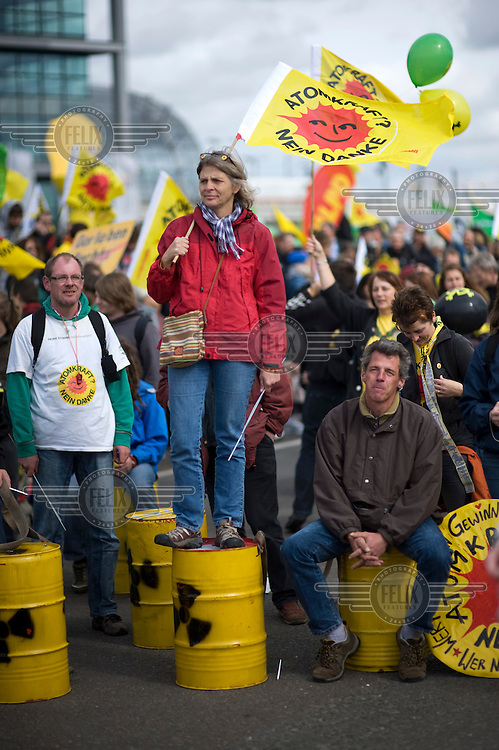 Anti-nuclear protestors march during a demonstration in Berlin. Tens of thousands of people took part in the protest against highly divisive government plans to extend the life of Germany's 17 nuclear reactors beyond a planned shut down of around 2020.