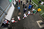 The teams emerging from the dressing rooms before the Spartans (in white) versus University of Stirling Scottish Lowland League match at Ainslie Park, Edinburgh. The match was one of six attended by members of GroundhopUK over the weekend to accommodate groundhoppers, fans who attempt to visit as many football venues as possible. Around 100 fans in two coaches from England participated in the 2016 Lowland League Groundhop and they were joined by other individuals from across the UK which helped boost crowds at the six featured matches.