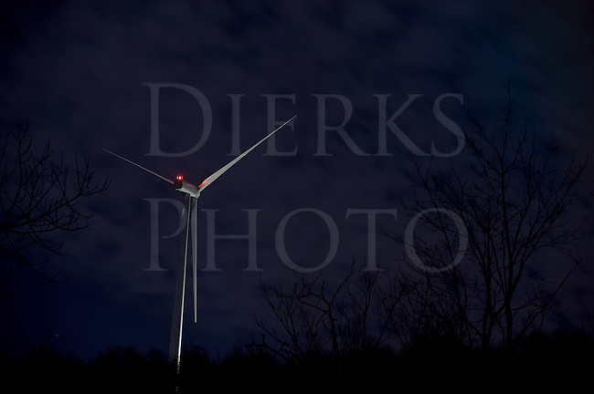 Wind energy windmill turbine at night under fluffy clouds and silhouetted trees, eight second time exposure, clean shot using Nikon D3s at ISO 200, Altoona, PA, USA.
