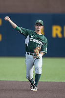 Michigan State Spartans shortstop Royce Ando (13) makes a throw to first base against the Michigan Wolverines during the NCAA baseball game on April 18, 2017 at Ray Fisher Stadium in Ann Arbor, Michigan. Michigan defeated Michigan State 12-4. (Andrew Woolley/Four Seam Images)