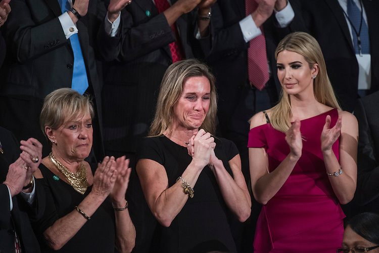 "UNITED STATES - FEBRUARY 28: Carryn Owens, widow of Navy SEAL, William ""Ryan"" Owens, reacts after being recognized by President Donald Trump during his address to a joint session of Congress in the Capitol's House Chamber, February 28, 2017. (Photo By Tom Williams/CQ Roll Call)"