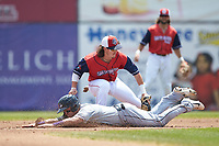 Evan Skoug (19) of the Winston-Salem Dash is tagged out by San Bernardos de Salem shortstop Ryan Fitzgerald (19) as he slides into second base at Haley Toyota Field on June 30, 2019 in Salem, Virginia. The Dash defeated the San Bernardos 3-2. (Brian Westerholt/Four Seam Images)