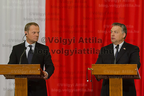 Donald Tusk (L) prime minister of Poland and his counterpart Viktor Orban (R) Prime Minister of Hungary talk during a press conference in Budapest, Hungary on January 29, 2014. ATTILA VOLGYI