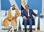Egyptian President, Abdel Fattah al-Sisi, meets with United Arab Emirates Vice President and Prime Minister and Ruler of Dubai, Sheikh Mohammed bin Rashid al-Maktoum following the inauguration ceremony for the new additions to the Suez Canal, Egypt, 06 August 2015. The latest addition to the canal comes in at 35 kilometers of new canal and the widening of a further 37 kilometers of old canal, was completed in under a year, with an estimated cost of 8.5 billion US dollars once additional projects are completed, and was opened to shipping 06 August. According to the Egyptian Government the additional chanel cuts journey times from an estimated 18-14 hours to 11 hours, making it the fastest shipping lane of its kind worldwide, and will double revenue by 2023, though their figures have been widely disputed by international economists. Photo by Egyptian President Office