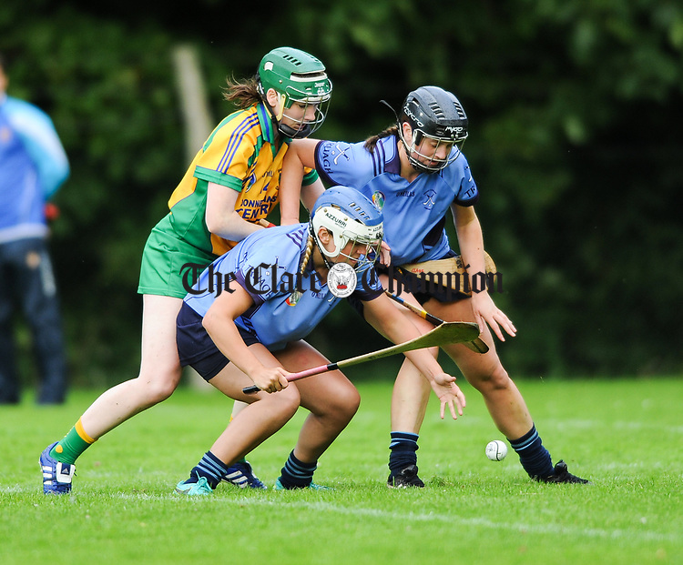 Fiona Lafferty of Inagh-Kilnamona in action against Marie Begley and Aideen Hogg of Truagh-Clonlara during their first round senior championship game in Shannon. Photograph by John Kelly