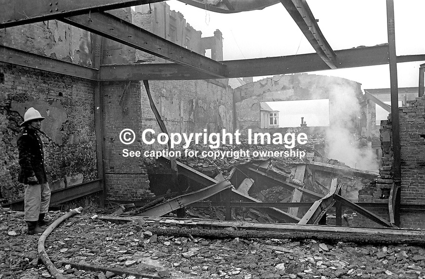 Main Street, Portrush, Co Antrim, N Ireland - mopping up after an overnight bombing blitz by the Provisional IRA. The IRA's 8 bombs were at the height of the popular resort's holiday season. 4th August 1976. 197608040336c<br /> <br /> Copyright Image from Victor Patterson, 54 Dorchester Park, Belfast, UK, BT9 6RJ<br /> <br /> Tel: +44 28 9066 1296<br /> Mob: +44 7802 353836<br /> Voicemail +44 20 8816 7153<br /> Email: victorpatterson@me.com<br /> <br /> <br /> IMPORTANT: If you wish to use this image or any other of my images please go to www.victorpatterson.com and click on the Terms &amp; Conditions. Then contact me by email or phone with the reference number(s) of the image(s) concerned.