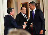 United States President Barack Obama, right, shakes hands with King Abdullah II of Jordan, left, as President Hosni Mubarak of Egypt, center, looks on following statements in advance of the opening of the first direct talks in two years between Israel and the Palestinian Authority scheduled to begin at the State Department in Washington, D.C. tomorrow in the East Room of the White House following their bi-lateral meetings  in Washington, D.C. on Wednesday, September 1, 2010.  .Credit: Ron Sachs / Pool via CNP.(RESTRICTION: NO New York or New Jersey Newspapers or newspapers within a 75 mile radius of New York City)