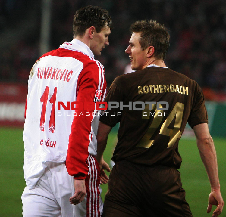 1.FC K&ouml;ln vs. FC St.Pauli 1:1, 01.02.2008<br /> <br /> Goalgetter Milivoje Novakovic (Nr.11) im Streit mit Carsten Rothenbach (St.Pauli Nr.24).<br /> <br /> Foto: &copy; nph (nordphoto)<br /> <br /> *** Local Caption ***