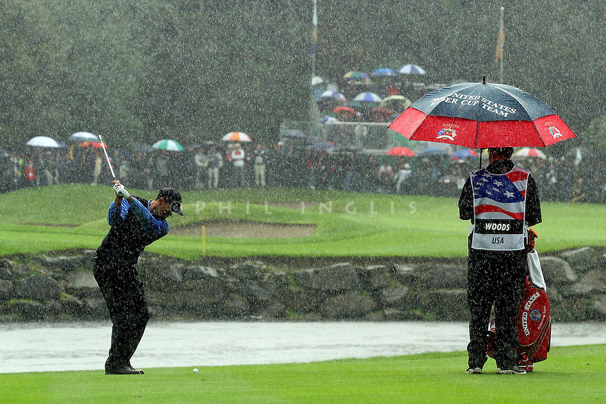 Tiger Woods of the US Team hits his approach shot in torrential rain to the 16th green whilst playing the Saturday am.  Fourballs during the 36th Ryder Cup Matches on The Palmer Course at The K Club, Straffan, Co. Kildare, 23rd September 2006 ( Photo by Phil Inglis ).