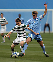 Owen Darby (7) and Kirk Urso (3) colide during the NCAA 2011 Men's College Cup between the North Carolina Tar Heels and the Charlotte 49ers  in Hoover, AL on Sunday, December 11, 2011.