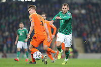 16th November 2019; Windsor Park, Belfast, County Antrim, Northern Ireland; European Championships 2020 Qualifier, Northern Ireland versus Netherlands; Northern Ireland's Niall McGinn goes past Matthijs de Ligt of Netherlands  - Editorial Use