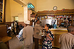 deguster un macchiato dans un des nombreux cafes d asmara est le passe temps favori des Asmarinos, les habitants d Asmara. Bar tre stelle..Tre stelle bar. old regulars wearing Borsalino hats sip wonderful macchiatos in lively surrounds. Vintage gaggia cofe machine.