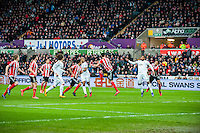 Ashley Williams of Swansea City  misses a header during the Barclays Premier League match between Swansea City and Southampton  played at the Liberty Stadium, Swansea  on February 13th 2016