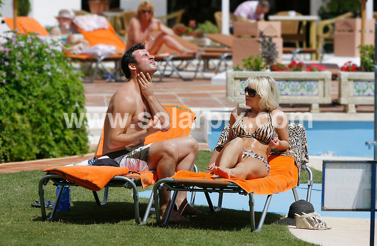 **ALL ROUND EXCLUSIVE PICTURES FROM SOLARPIX.COM**.**WORLD SYNDICATION RIGHTS**.Contrary to recent newspaper reports that the couple had split up, undefeated World Super Middleweight boxing Champion Joe Calzaghe 38,and Strictly Come Dancing girlfriend Kristina Rihanoff 32 were spotted taking an intimate stroll on a Spanish beach this week. The lovebirds were spending a relaxing few days at a luxury Beach & Spa resort after Kristina's latest dance tour. .This pic: Joe Calzaghe & Kristina Rihanoff.JOB REF: 11237        AB/SF       DATE:   16.05.10.**MUST CREDIT SOLARPIX.COM OR DOUBLE FEE WILL BE CHARGED**.**MUST AGREE FEE BEFORE ONLINE USAGE**.**CALL US ON: +34 952 811 768 or LOW RATE FROM UK 0844 617 7637**