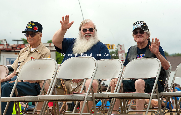 TORRINGTON,  CT--- -053016JS05- Veterans wave to the crowd as they ride in the annual Torrington Memorial Day parade on Monday. <br />  Jim Shannon Republican-American
