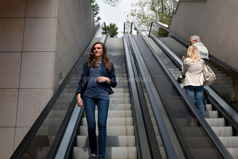Stefanie A, a student of the International University of Monaco, descends an outdoor escalator in Fontvielle, Monaco, 19 April 2013