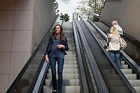 Stefanie A, a student of the International University of Monaco, descends an outdoor escalator in Fontvielle, Monaco, 19 April 2013