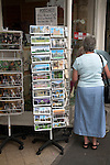 Display of postcards on a rack outside a shop, Wells, Somerset, England