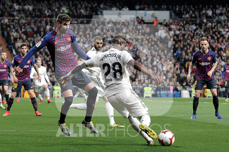 Real Madrid CF's Vinicius Junior  and FC Barcelona's Gerard Pique during La Liga match. March 02,2019. (ALTERPHOTOS/Alconada)