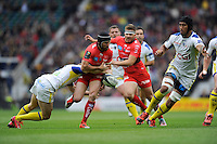 Matt Giteau of RC Toulon loses the ball as he is tackled by Nick Abendanon of ASM Clermont Auvergne