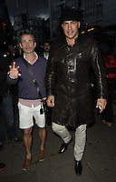 Julian Bennett & Tamer Hassan.attended the Kensington Club new boutique nightclub launch party, The Kensington Club, High Street Kensington, London, England,.20th July 2012..full length brown leather coat hat white shorts .CAP/CAN.©Can Nguyen/Capital Pictures.