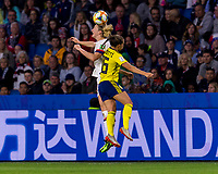 LE HAVRE,  - JUNE 20: Sam Mewis #3 goes up for a header with Julia Zigiotti #16 during a game between Sweden and USWNT at Stade Oceane on June 20, 2019 in Le Havre, France.