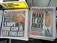 Headlines of New York newspapers on Wednesday, May 17, 2017 report on President Donald Trump allegedly urging then FBI chief James Comey to drop probe into Michael Flynn and Russian connections. (© Richard B. Levine)
