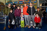 Pictured: (L-R)Mike van der Hoorn, Oli McBurnie, Daniel James, Matt Grimes, Joe Rodon, Courtney Baker-Richardson and Wayne Routledge of Swansea City  buying children gifts at Smyth's Toy Store, in Swansea, Wales, UK. Wednesday 19 December 2018
