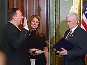 United States Representative Mike Pompeo (Republican of Kansas), left, is sworn-in as Director of the Central Intelligence Agency (CIA) by US Vice President Mike Pence, right, in the Vice President's ceremonial Office at the White House in Washington, DC on Monday, January 23, 2017.  Pompeo was accompanied by his wife, Susan, center.<br /> Credit: Ron Sachs / Pool via CNP