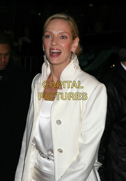 "UMA THURMAN .""The Producers"" New York Premiere at the Ziegfeld Theatre, New York City..December 4th, 2005 .Ref: IW.half length white silk satin dangling earrings diamante belt mouth open.www.capitalpictures.com.sales@capitalpictures.com.©Capital Pictures"